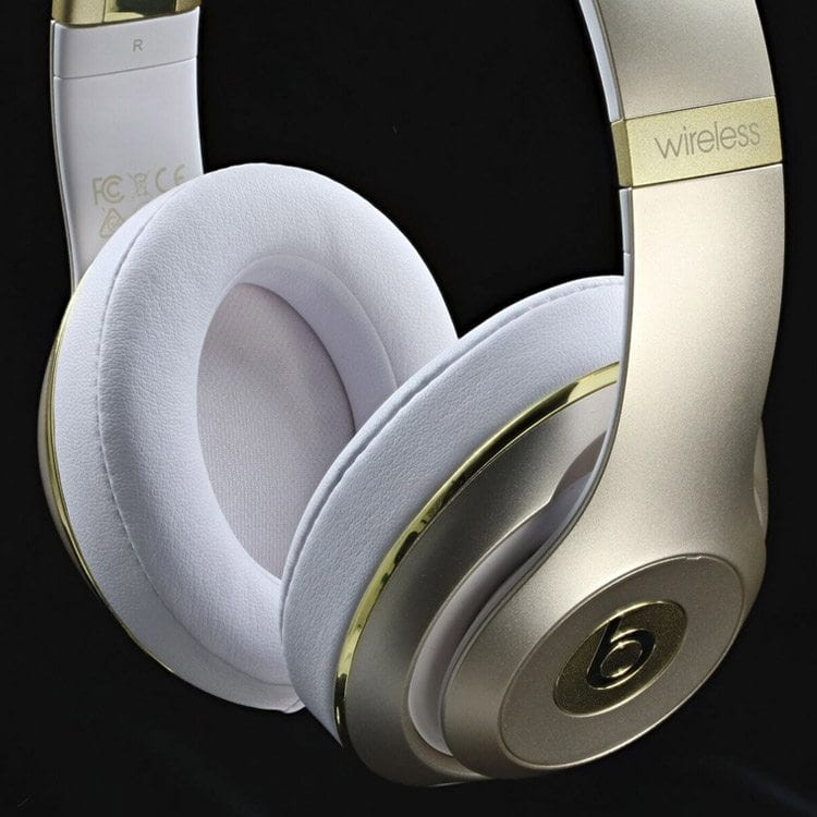 beats by dr dre gold and white muffs shot for electronic product photography example