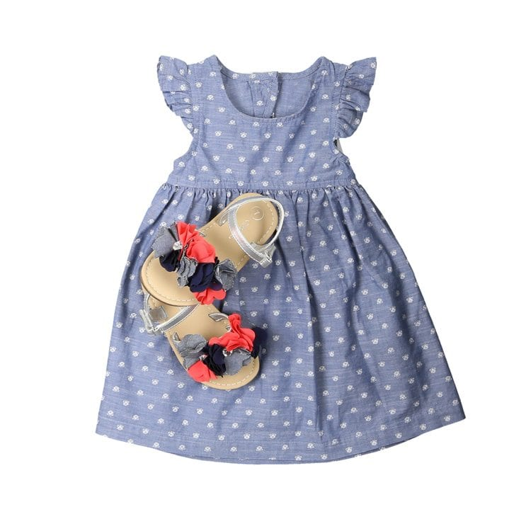 blue with white polka dots with small colorful sandals for apparel product photography example